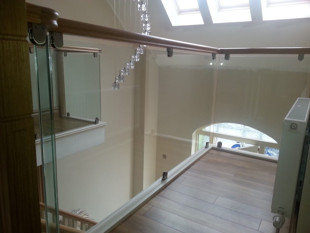 Glass Timber Stairs fitted with Steel Clamps